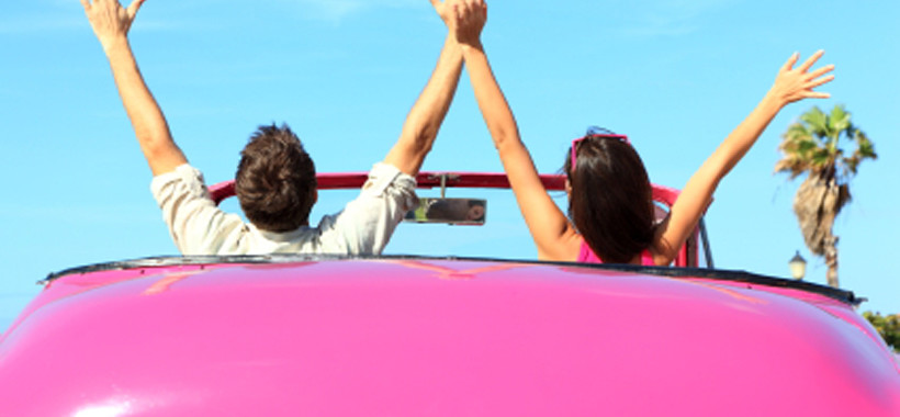 Freedom - happy free couple in car