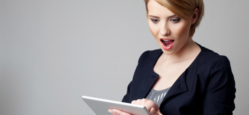 Surprised-Woman-Reading-Tablet