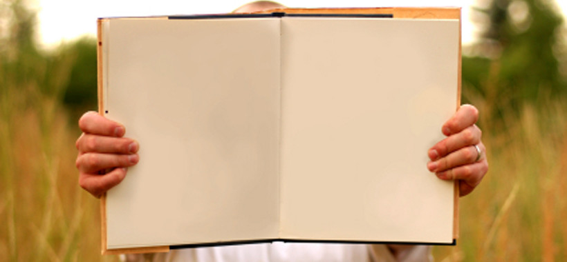 Man Holding Blank Book