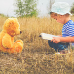 Cute girl reading book Teddy bear1