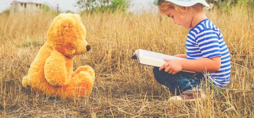 Cute girl reading book Teddy bear1